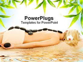 PowerPoint template displaying blond woman receiving hot stone spa treatment on beach with green leaves