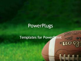 PowerPoint template displaying football on grass athletes playing sports team sports team work