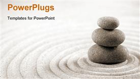 PowerPoint template displaying three stacked stones on raked sand in the background.