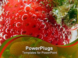 PowerPoint template displaying fresh strawberry under the water covered with bubbles in the background.