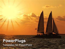 PowerPoint template displaying sailing at Sunset under a beautiful orange sky in the background.
