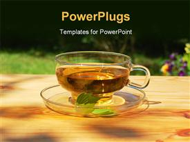 PowerPoint template displaying transparent cup of tea and saucer with leaf and flowers in background