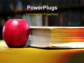 Red apple on a thick book on a desk in a library presentation background