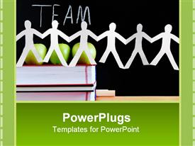 PowerPoint template displaying paper dolls on stack books in front of three green apples and blackboard with Team