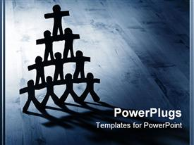 PowerPoint template displaying teamwork metaphor with paper people in pyramid on wood