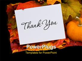 PowerPoint template displaying thank you card with a gourd sitting on a fall leaf background