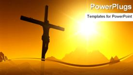PowerPoint template displaying a sunset view of a cross with Jesus Christ