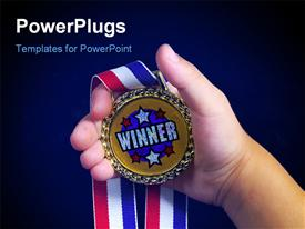PowerPoint template displaying hand holding winners medal with multicolored ribbon on blue background