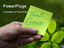 PowerPoint template displaying green Eco Innovation sustainability concept, Person holding green sticky note with Think Green in the background.