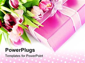 PowerPoint template displaying pink tulips on pink gift box with ribbon on polka dot background