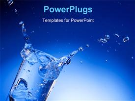 PowerPoint template displaying splash of mineral water with ice cubes in a transparent glass