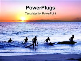 PowerPoint template displaying sun set view of surfers coming out of an ocean