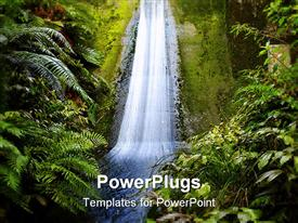 PowerPoint template displaying waterfall flowing down wall in tropical jungle