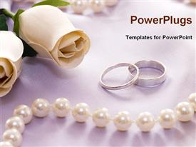 Wedding rings with flower and pearl necklace presentation background
