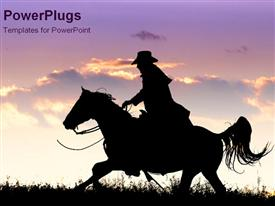 Cowboy rides horse into sunset presentation background