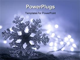 PowerPoint template displaying frozen ice snowflake with soft christmas lights