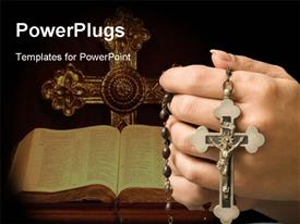 PowerPoint template displaying holy Bible and crucifix on black background with hand holding rosary