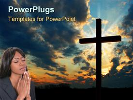 PowerPoint template displaying big cross with a lady closing her eyes and praying beside it