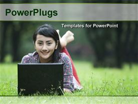 PowerPoint template displaying young Asian woman with laptop lying on green grass