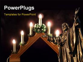 PowerPoint template displaying burning candles with statue of Jesus in cathedral