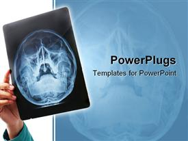 PowerPoint template displaying hand holding up X-ray scan of human skull for examination
